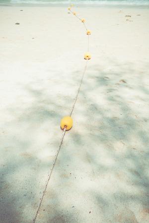 beach buoy: Yellow buoy on the beach
