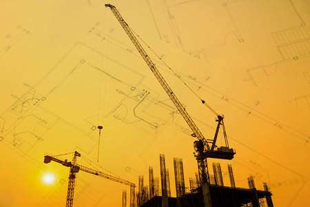 buildingsite: Construction site with cranes on silhouette with drawing background Stock Photo