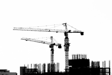 Construction site with cranes on silhouette background Imagens