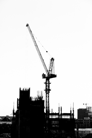 Construction site with cranes on silhouette background Stock fotó