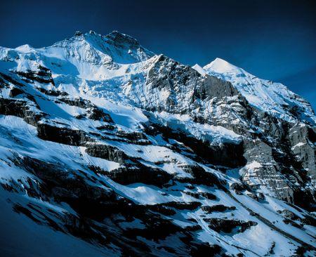 Rugged Mountain with Snow Фото со стока