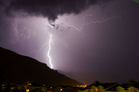Huge Lightning bolt over hill Stock Photo - 565418