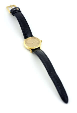 wristlet: A female golden wrist watch with leather wristlet.