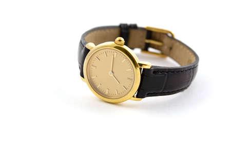 punctual: Un reloj de pulsera de oro femenina con cuero wristlet.