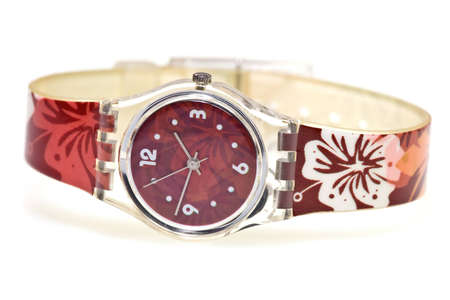 wristlet: A female stylish wristlet watch isolated on white background.