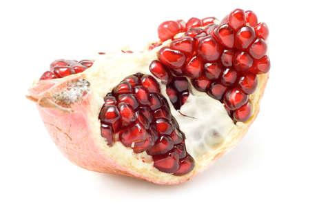 Piece of ripe pomegranate isolated on white background. Stock Photo - 1647376