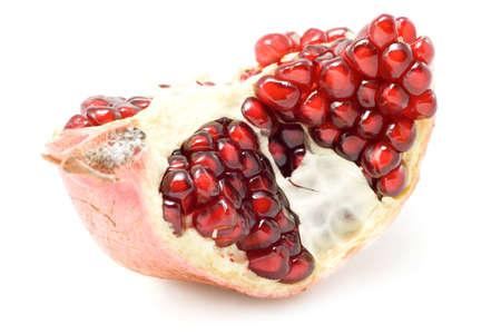 Piece of ripe pomegranate isolated on white background. Stock Photo - 1647376