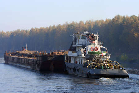 pushed: Barge pushed by towboat on the river.