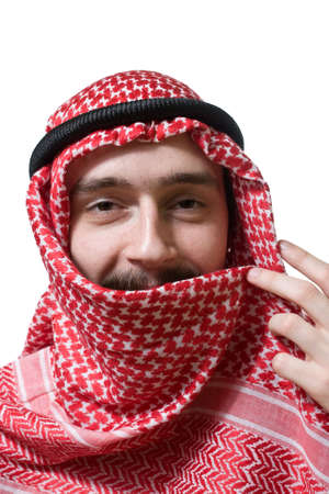 red scarf: Portrait of smiling arabian young man in traditional headscarf Stock Photo