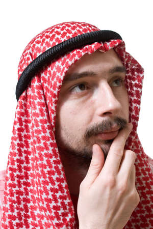 shemagh: Portrait of an arabian young man in traditional headscarf. He is thoughtful. Stock Photo