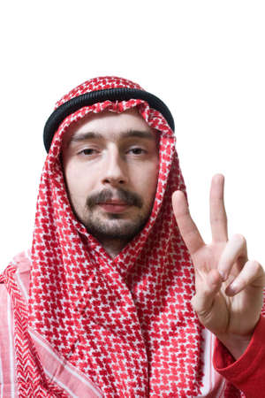 shemagh: Portrait of an arabian young man in traditional headscarf. He shows peace sign by hand.