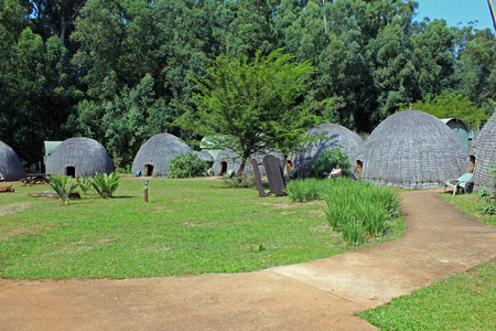 Traditional houses in Swaziland as part of a national park Stockfoto - 122881643