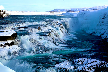 Gullfoss waterfall with blue water in winter at Golden Circle in Iceland Stockfoto