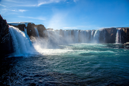 Godafoss waterfall with sunny blue sky in Iceland