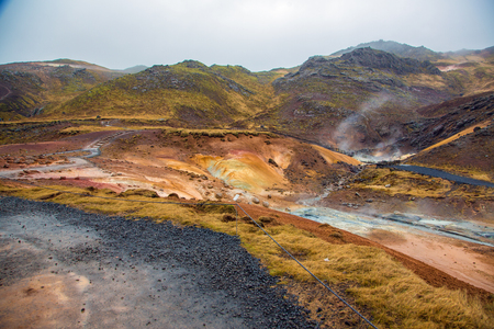 Geothermal area in Iceland near Reyjavik with colorful mineral rocks