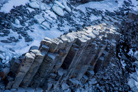 Basalt column formation in a canyon in winter with birds eye view Stockfoto
