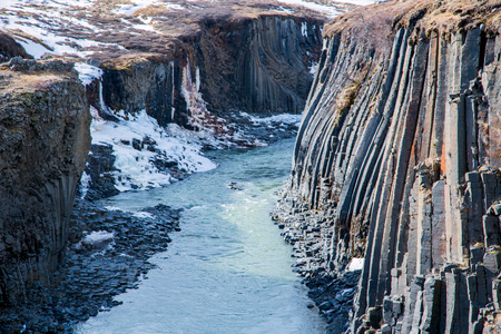 Basalt column formation in a canyon in winter in the highlands of iceland Stockfoto - 124810300