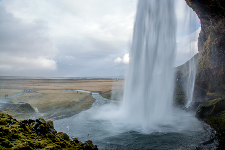 Back of a waterfall out of cave - Seljalandsfoss in Iceland