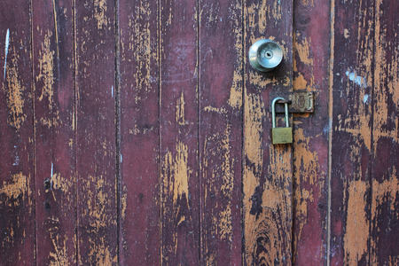 Old wooden doors and Corroded with aluminum handle and rustykey photo