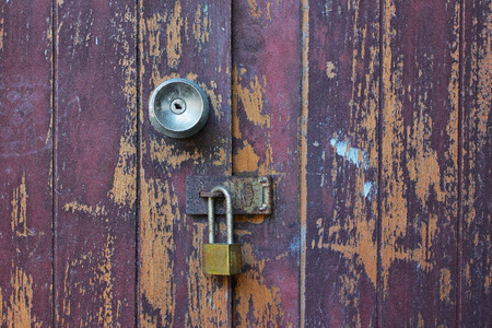 corroded: Old wooden doors and Corroded with aluminum handle and rustykey