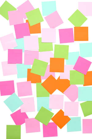 many sticky notes on white wall