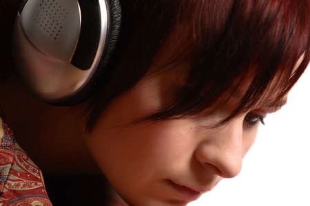 close-up face of young girl with hwadphones Stock Photo
