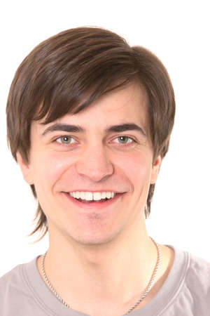 friendly dark-haired man smiling on white close up Stock Photo