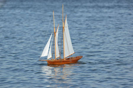 scurvy: sailing ship model on blue water sail to the left