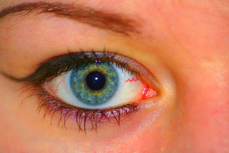 1 person: close-up human eye in not natural colors
