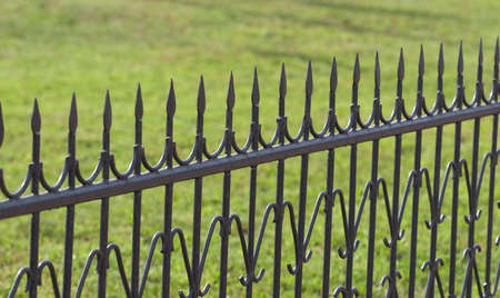 iron fence on grass background