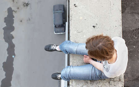 girl sit on edge of roof