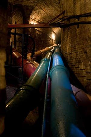 old steel pipe in underground tunnel
