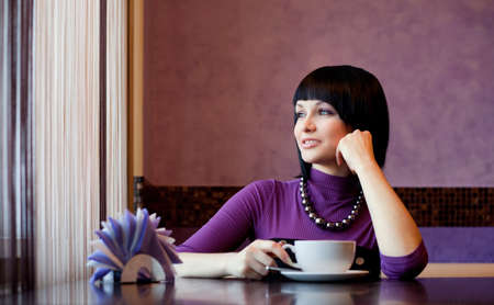 girl in cafe with coffee cup smiling Stock Photo