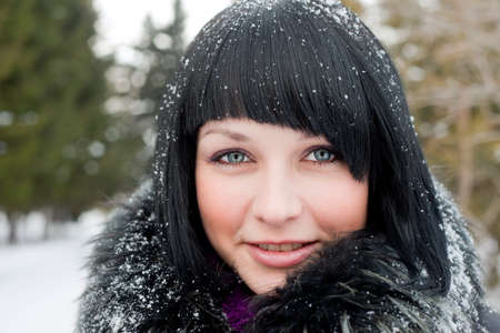 girl in snowflake look at camera smiling photo