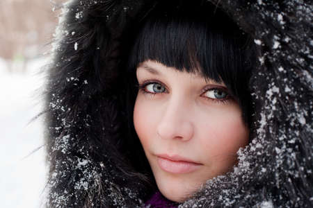girl in fur hood and snow photo