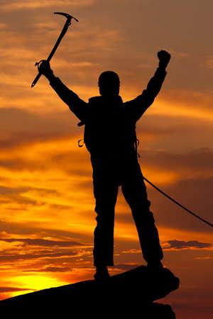 rockclimber: silhouette of rock climber on sunset sky