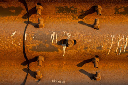 old rusty metal with bolts photo