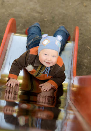 hillock: smiling baby lie on hillock Stock Photo