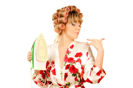 haircurlers: housewife in haircurlers and iron in hand Stock Photo
