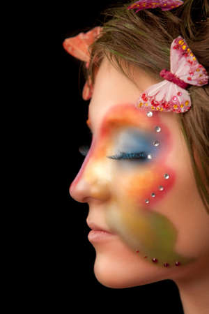 girl with butterfly make-up on face profile portrait photo