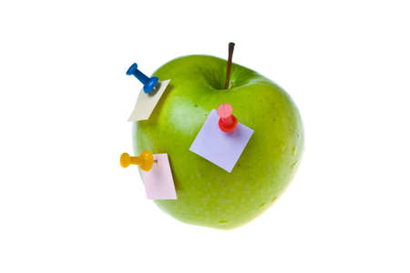 green apple with paper sticks