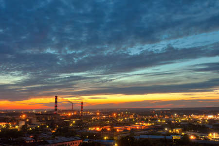 industrial power plant night landscape with lights photo