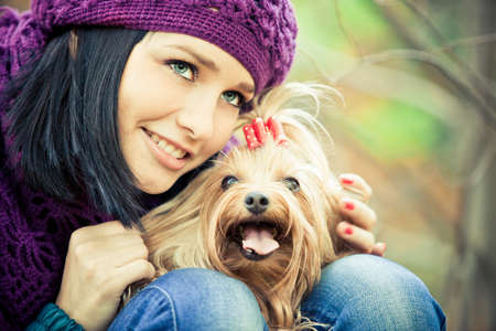 cute girl with small terrier dog photo