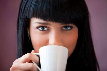 girl drink coffee close up portrait Stock Photo - 12646008