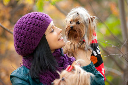 girl lovely look at small dog in her hands Stock Photo