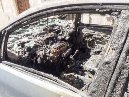 burned out interior of car after explosion