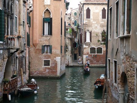 Typical Venetian scene with houses and canal. Venice Italy