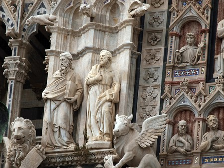 Architectural details of Duomo facade - Siena,Tuscany,Italy. The Duomo of Siena, which was built in the 12th and 13th centuries, is one of the prettiest churches in Gothic style in Italy