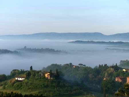 montepulciano: Fabulous landscape of the foggy morning in Tuscany. The valley between Montepulciano and Chiusi