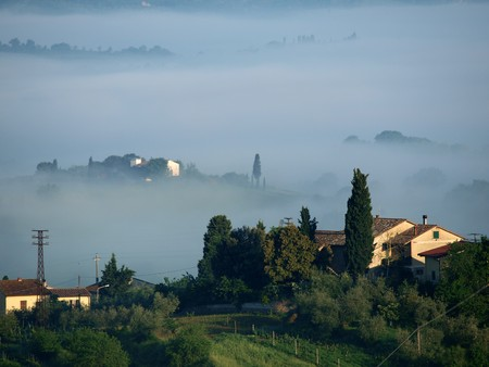 Fabulous landscape of the foggy morning in Tuscany. The valley between Montepulciano and Chiusi Stock Photo - 7247003